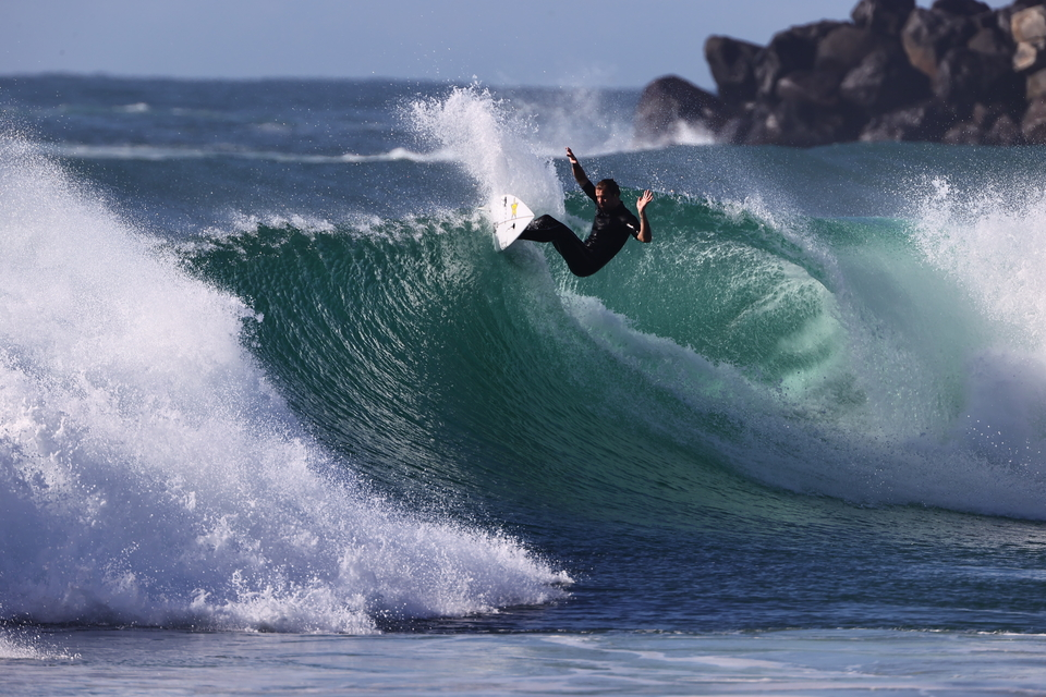 """Mitch Crews, meeting the lip half way, Duranbah. """"He's like a fine wine, maturing,"""" says photographer Swilly. """"His rail game especially. He moved board-makers to his brother Alex and it really seems to be a good fit. It's nice to see someone who's really competent and out there killing it."""""""