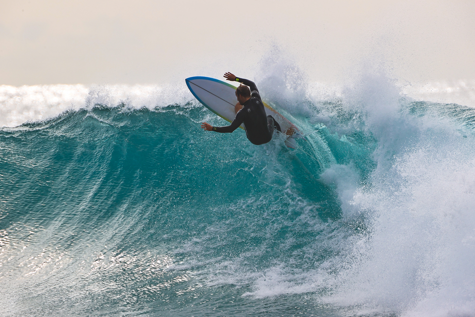 """Josh Kerr feeling the lip, Rainbow Bay. From the photographer again: """"The board he's riding there is a kind of mid length twin fin. Like Asher Pacey said, if he'd got on a twinnie when he was back on tour, imagine how many heats he'd have won."""""""