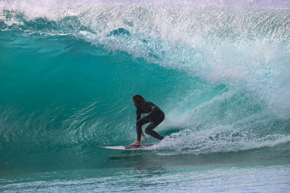 Toby Mossop, playing with the wave base, Tuesday at Burleigh Heads.