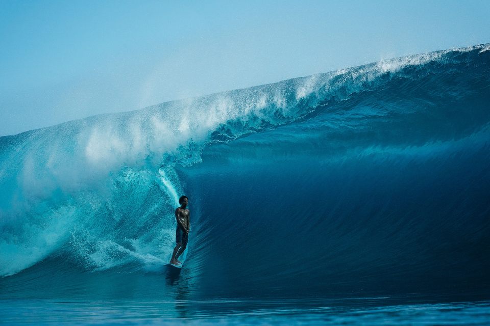 Some of Tommy's images transcended the realms of humble surf media. This image, of Matahi Drollet at home in Teahupoo, went everywhere.