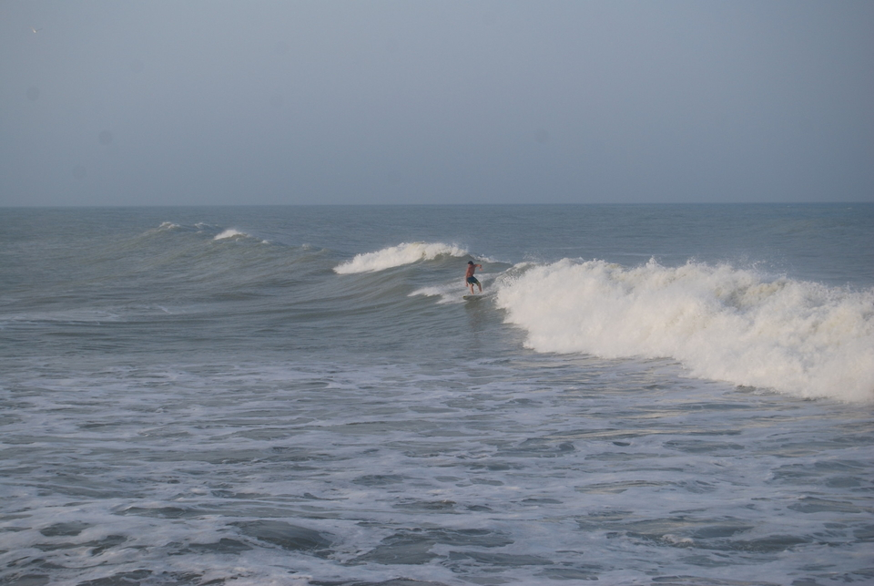 Surfing during post cyclone Knuckles.