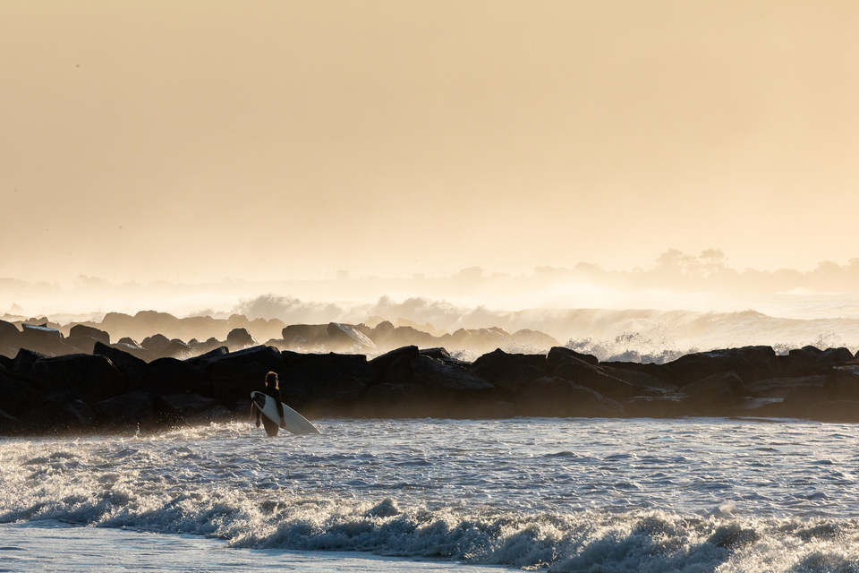 Lone surfer about to dig into the Rockaway express.