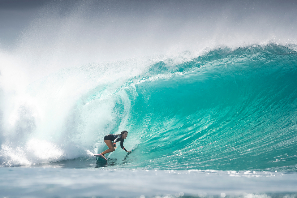 """The older of the Johnson sisters, Pua Johnson is courageous in surf of any size, and recently took 2nd place in an open men's online surf contest with her five-second barrel at perfect Desert Point. """"I love being a woman,"""" she says. """"It gives me something to prove."""""""