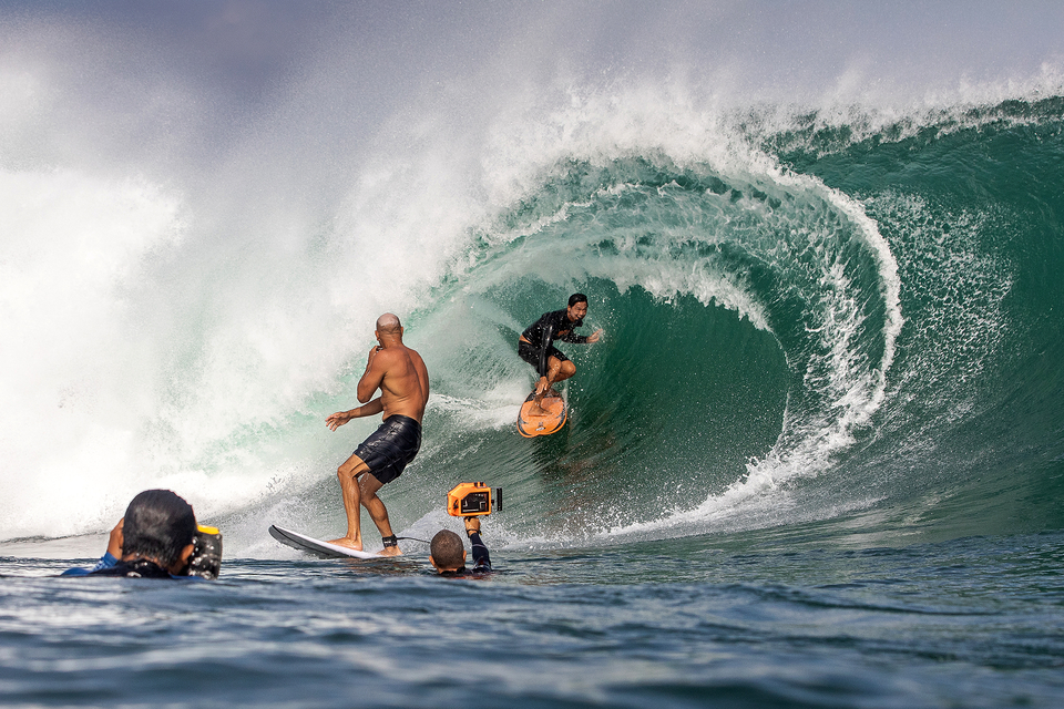 Having surfed with each other since the 80s, Kelly and Rizal often trade barrels on the same wave. Here, Kelly becomes part of the audience as Rizal starts his run.