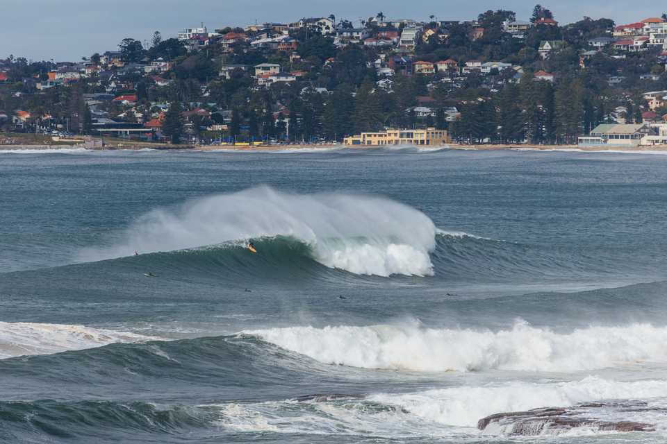 Just think, it's all within sight of Sydney's much coveted real estate. Matt Chojnacki, trying to push down one.