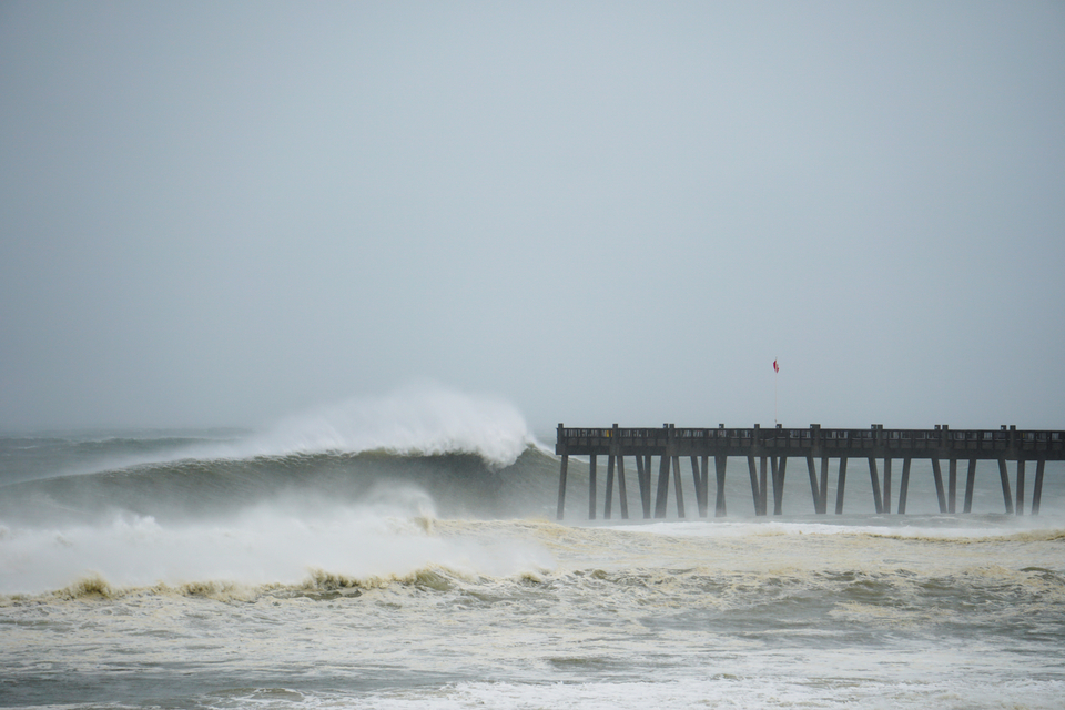 Pensacola beach pier engulfed with 25ft plus waves.