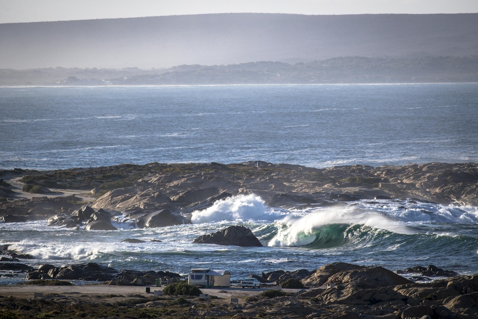 One of the very many different waves in the area, and the view as you drive in and down the hill.