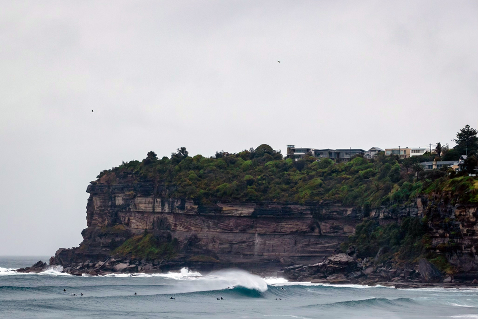 As the swell built that arvo, lots of people got amongst it, possibly to realise they were under-rubbered. South Avalon.